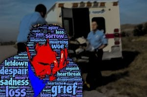 grief with ambulance in background